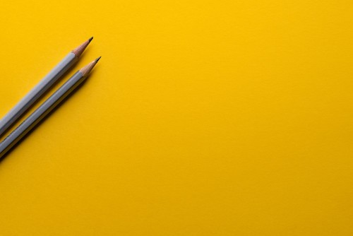Yellow Paper with Pencils